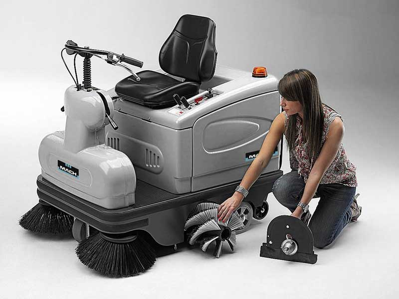 A lady cleaning the Mach 2 Floor Sweeper