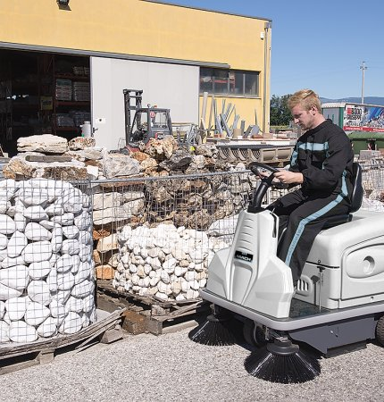 Man driving the Mach 3 Floor Sweeper