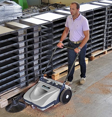 An old man seems to be happy pushing a A young man behind one of our Mach MEP Floor Sweeper