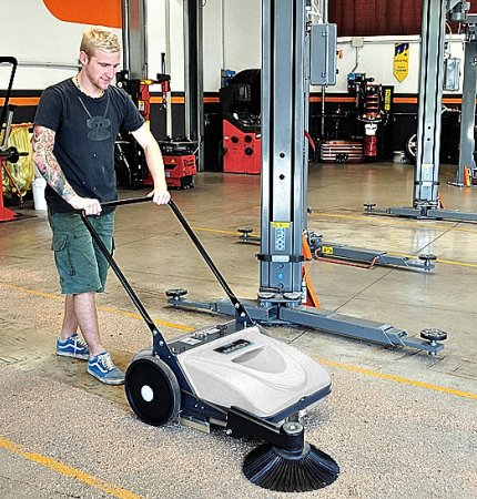 A young man behind one of our Mach MEP Floor Sweepers